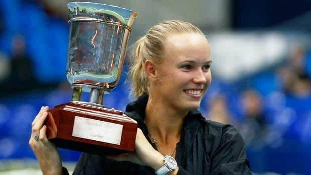 Caroline Wozniacki lifts her trophy after defeating Australia's Samantha Stosur in the women's singles final at the Kremlin cup in Moscow on Sunday.