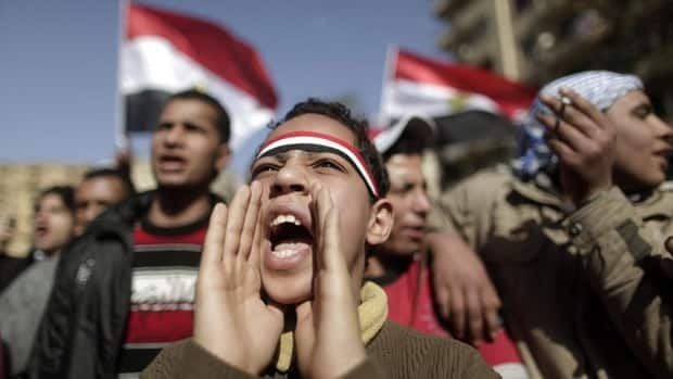 An Egyptian youth shouts slogans during a protest in Tahrir Square in Cairo, Egypt, on Thursday, one day after hundreds of thousands of Egyptians marked the first anniversary of the uprising that toppled Hosni Mubarak.