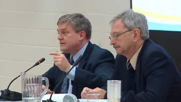 Premier David Alward appeared at a public meeting with Finance Minister Blaine Higgs in January. Alward announced major changes to the province's pension rules on Thursday.