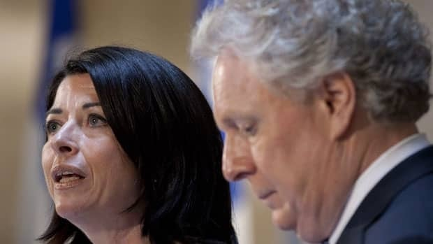 Quebec Education Minister Line Beauchamp announces her resignation as Premier Jean Charest looks on.