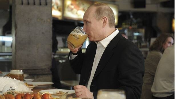 Vladimir Putin drinks beer at a self-service restaurant after taking part in an International Workers' Day march in Moscow on May 1, before he became Russian president. On Tuesday, a law that bans selling beer at Russia's kiosks took effect, but it can still be sold at restaurants, cafés and stores of at least 500 square feet.
