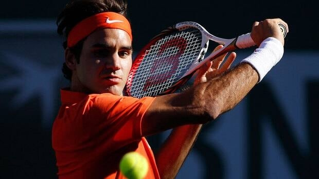Roger Federer of Switzerland returns a shot against Ivan Dodig of Croatia during their match at the BNP Paribas Open tennis tournament Monday.
