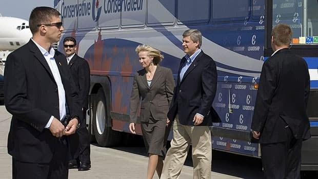 Prime Minister Stephen Harper and his wife Laureen are guarded by a security detail as they get off their campaign bus in 2008. On Friday, a former member of that detail, Bruno Saccomani, was named Canada's ambassador to Jordan.