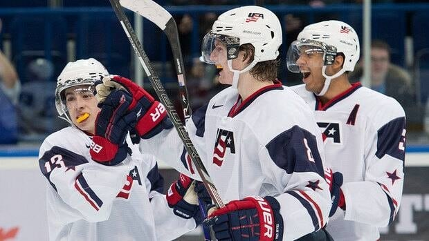 Team USA teammates John Gaudreau, left, Jacob Trouba, centre, and Seth Jones celebrte a goal against the Czech Republic during the third period of their quarter-final game Wednesday at the world junior hockey championship.