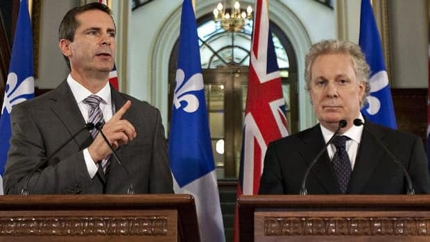 Ontario Premier Dalton McGuinty and Quebec Premier Jean Charest say the federal government will try to download responsibilities to the provinces in the upcoming budget.