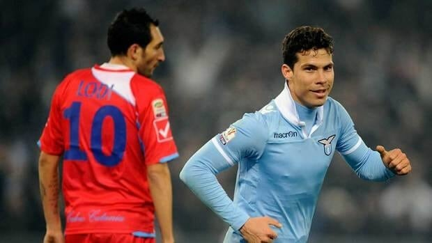 Lazio's Hernanes, right, celebrates past Catania's Francesco Lodi after he scored during an Italian Cup quarter-final match between Lazio and Catania, at the Rome Olympic stadium on Tuesday.