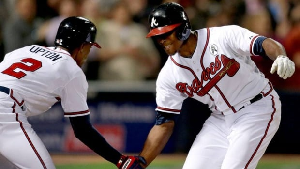 Justin Upton, right, has smacked an MLB-best 11 homers while the Braves wait for older brother B.J., left, to bust out of his slump.