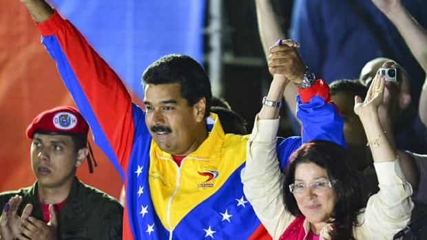 Venezuelan acting President Nicolas Maduro celebrates next to his wife Cilia Flores after the electoral council announced that he had won in a close battle.