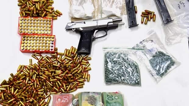A Thunder Bay police raid Wednesday at St. Patricks Square netted a 9-mm Ruger, with bullets in the magazine, hundreds of rounds of ammunition, oxycodone, cocaine and marijuana worth $180,000, as well as $29,000 in cash.