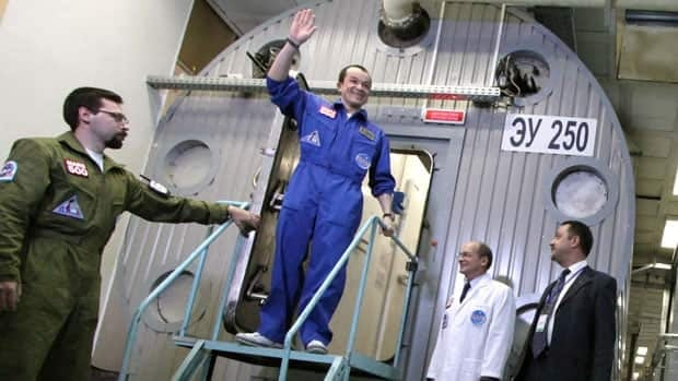 Researcher Sukhrob Kamolov leaving a set of windowless modules after a grueling 520-day simulation of a flight to Mars.
