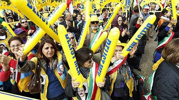 Demonstrators in front of the White House last year demand that Iranian opposition group Mujahedin-e Khalq be removed from a U.S. terror list. The group was delisted in the U.S. in September, and Canada announced it was doing the same Thursday.