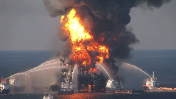 Fireboats battle the blazing remnants of the offshore oil rig Deepwater Horizon on April 21, 2010. The oil well off the coast of Louisiana gushed crude into the Gulf of Mexico for 87 days, but the ecological toll has lasted far longer.