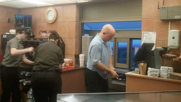 Tim Hortons staff working at a drive-thru where 228 people picked up the tab on the order of the customer that was next in line.