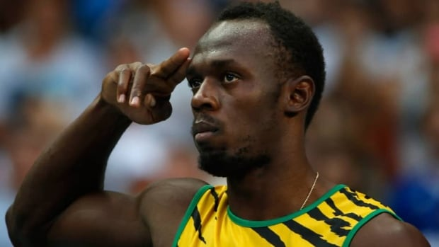 Jamaica's Usain Bolt gestures before competing in a men's 100-metre heat at the World Athletics Championships in the Luzhniki stadium in Moscow on Saturday.