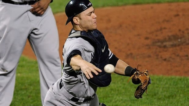 Yankees catcher Russell Martin throws out Orioles' Lew Ford at first base in the fifth inning of Game 1 of the American League Division Series.