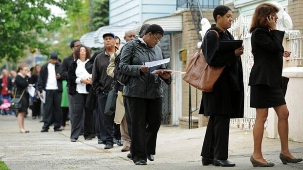 Job seekers line up for an employment fair in New York in May. The Fed is expected to act because the U.S. economy is growing too slowly to reduce unemployment.