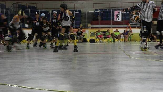 The referee calls the lead jammer during a jam at the Hammer City Harlot's game Saturday night.