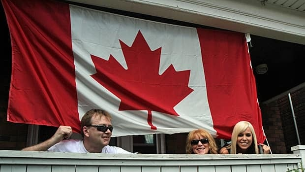 Peter Cushenan (left) joins Pam and Christine Armstrong on a front porch near Gage Park on Sunday. (Samantha Craggs/CBC)