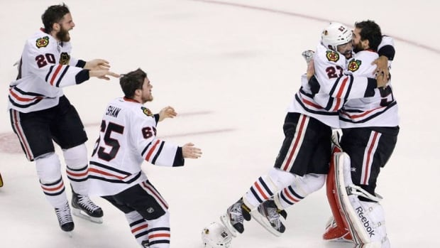 Members of the Chicago Blackhawks react to winning the Stanley Cup after defending the Boston Bruins in Game 6 Monday night.