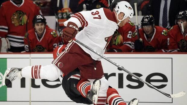 Chicago Blackhawks' Marian Hossa (81) falls down after taking a hit from Phoenix Coyotes' Raffi Torres in Game 3 of their Stanley Cup playoff series.