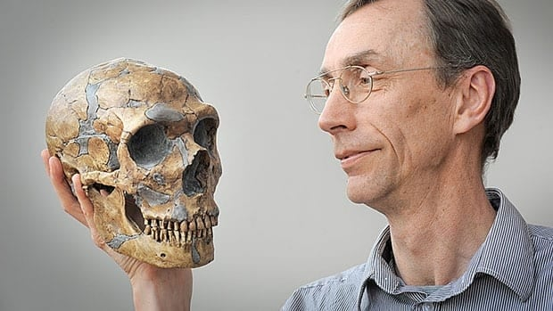 Svante Paabo holds a reconstructed skull of a Neanderthal. Paabo, a Swedish geneticist at the Max Planck Institute for Evolutionary Anthropology, is nearly finished mapping the DNA of the Neanderthal - DNA which exists in small amounts in modern humans.