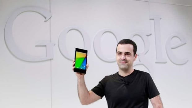 Hugo Barra, director of product management for Google's Android division, shows off the new Nexus 7 earlier this summer. The latest version of Android is being nicknamed Kit Kat, after the candy bar.