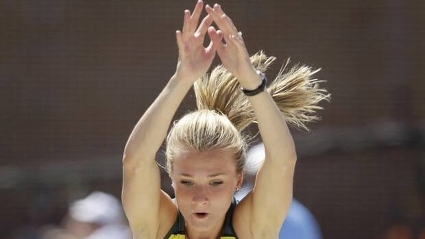 Oregon's Brianne Theisen leaps to the pit during the long jump event in the heptathlon competition at the NCAA outdoor track and field championships, Friday, June 8, 2012.