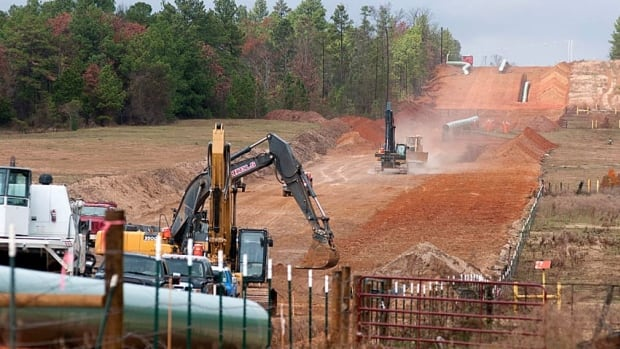 Crews work on construction of the TransCanada Keystone XL Pipeline east of Winona, Texas, on Monday, Dec. 3, 2012.