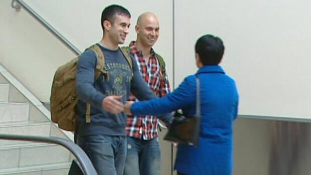 Dion and Neil Gibbons, greet their mother, Linda Gibbons, as they arrive at St. John's Airport after their eight-month tour of duty in Afghanistan.