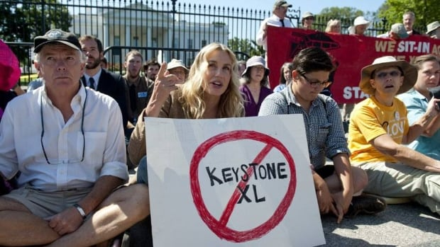 Protesters including U.S. actress Daryl Hannah, centre, denounce the planned Keystone XL pipeline outside the White House in August 2011. Most of the group, including Hannah, was arrested under regulations restricting protests in the area.