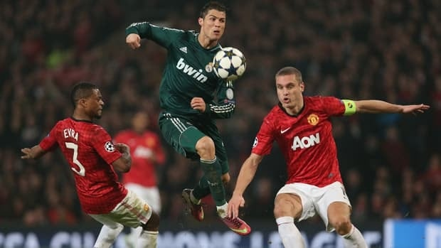 Cristiano Ronaldo of Real Madrid, centre, during the Champions League Round match against Manchester United at Old Trafford on March 5, 2013 in Manchester.