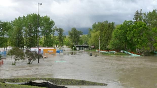 Bowness Park was flooded last month and likely won't reopen until 2015.