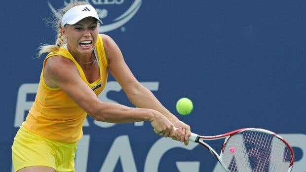 Caroline Wozniacki hits a backhand during her 6-2, 6-1 victory over Dominika Cibulkova, of Slovakia, in the quarter-finals of the New Haven Open on Thursday.