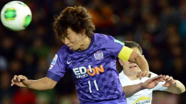 Hisato Sato of Sanfrecce Hiroshima heads the ball in Thursday's 1-0 win over Auckland City.