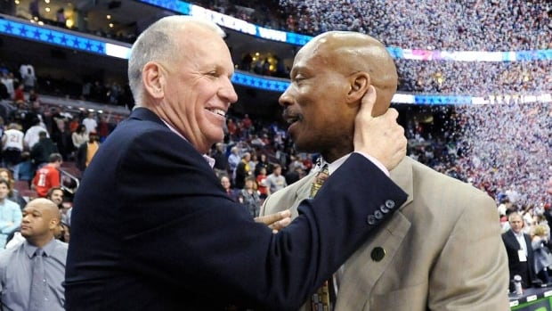 76ers head coach Doug Collins, left, talks to Cleveland Cavaliers counterpart Byron Scott at the end of Sunday's game in Philadelphia.