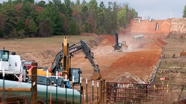 Crews work on the construction of the southern leg of the Keystone XL Pipeline east of Winona, Texas last month. TransCanada submitted a new application for the northern leg last spring.