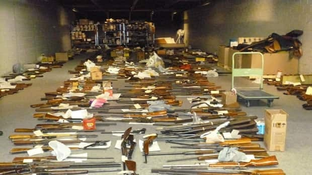 Some of the 1,700 firearms that were turned over to Winnipeg police as part of the Pixels for Pistols program. About 13,000 rounds of ammunition were also collected during the month-long initiative.