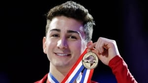 Max Aaron holds the gold medal after winning the men's title at the U.S. Figure Skating Championships on Sunday in Omaha, Neb.