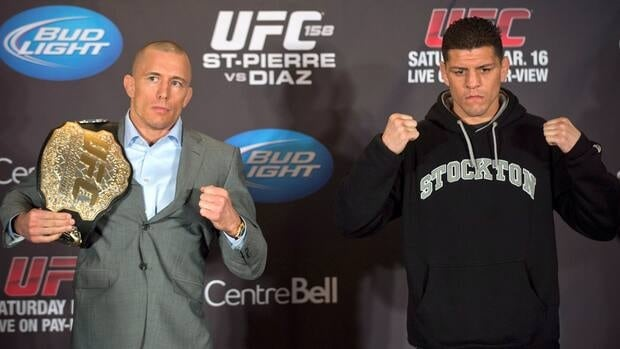 Georges St-Pierre, left, and Nick Diaz pose for the cameras following their news conference Thursday in Montreal.
