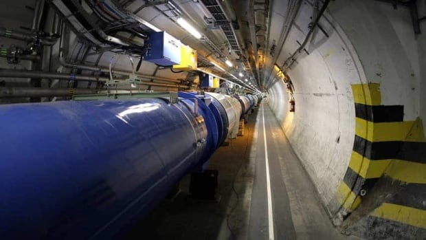 Researchers at the Large Hadron Collider near Geneva have spotted a particle that sheds some light on why the universe is filled with matter, and is not just an empty husk.
