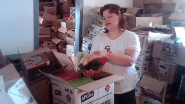 Shaunna Raycraft seen during one of her first efforts at sorting through a massive collection of books.