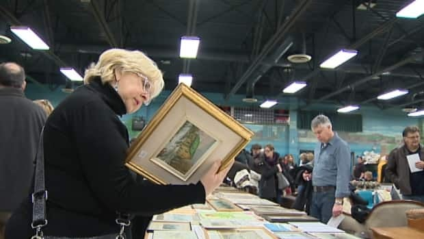 A police investigator is spreading the word about the seized hoard at a popular auction in Halifax. The RCMP say they hope the crowd can help identify some of the allegedly stolen loot.
