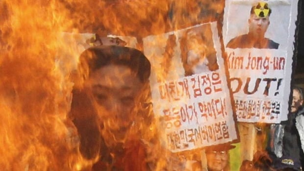 South Korean protesters burn an effigy of North Korean leader Kim Jong-un during an anti-North Korea rally denouncing the North's nuclear test in Seoul, South Korea. The detonation was the focus of global diplomatic manoeuvres.