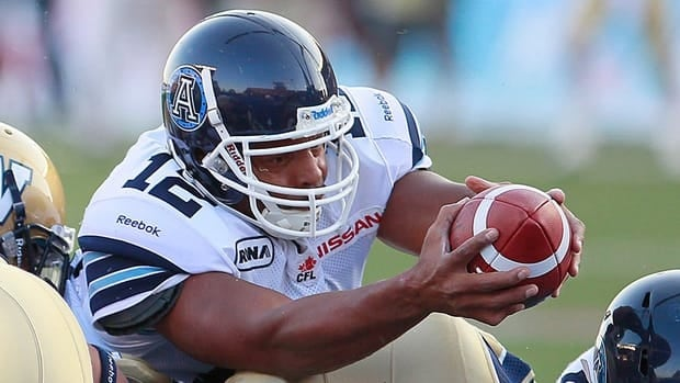 Argonauts' Jarious Jackson stretches across the line for the touchdown against the Blue Bombers in the first half of Saturday's game.