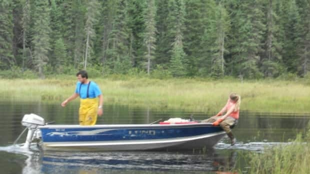 Trent University students conducting an experiment at the Experimental Lakes Area in northwestern Ontario last summer.