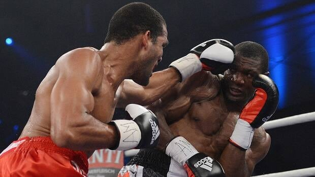 Cuba's Yoan Pablo Hernandez, left, against challenger Troy Ross of Canada during their IBF cruiserweight world title bout in Germany on Sept. 15, 2012.