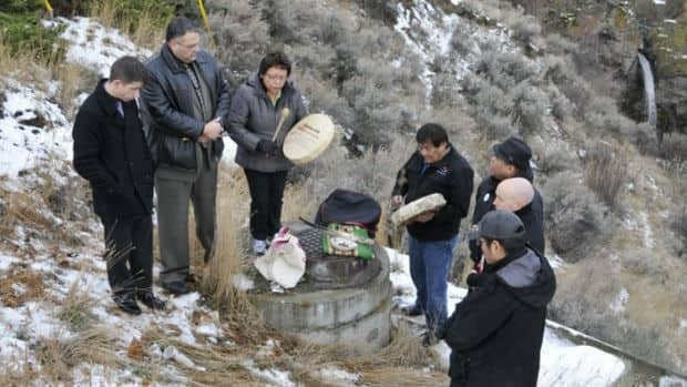 CJ Fowler's family, friends and a spiritual counsellor gather on Dec. 13, 2012, at the location in Kamloops where the teen's body was found. They held a private prayer ceremony to release CJ's spirit from the place where her life was taken.
