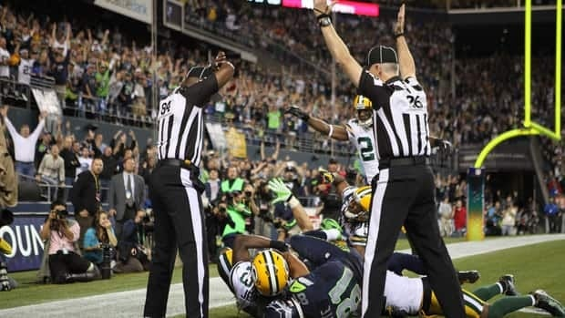 Wide receiver Golden Tate (81) of the Seattle Seahawks makes a catch in the end zone to defeat the Green Bay Packers on a controversial call by the officials Monday.