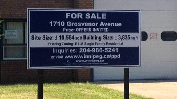 The City of Winnipeg has posted this for-sale sign outside the former fire hall on Grosvenor Avenue.