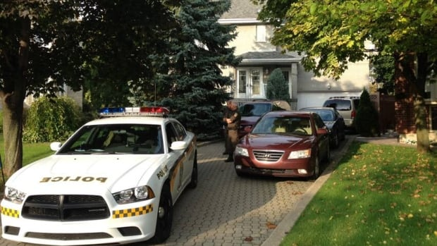 Police from Quebec's anti-corruption squad search the home of the mayor of Laval, Que., as part of a raid related to an investigation into the awarding of municipal contracts.